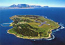 Robben Island with Table Mountain in the background - South Africa coach tours