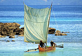 Malagasy fishermen return to their village on Nosy Komba