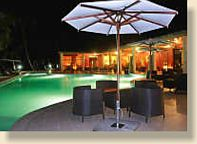 Soanambo Hotel general pool area at night